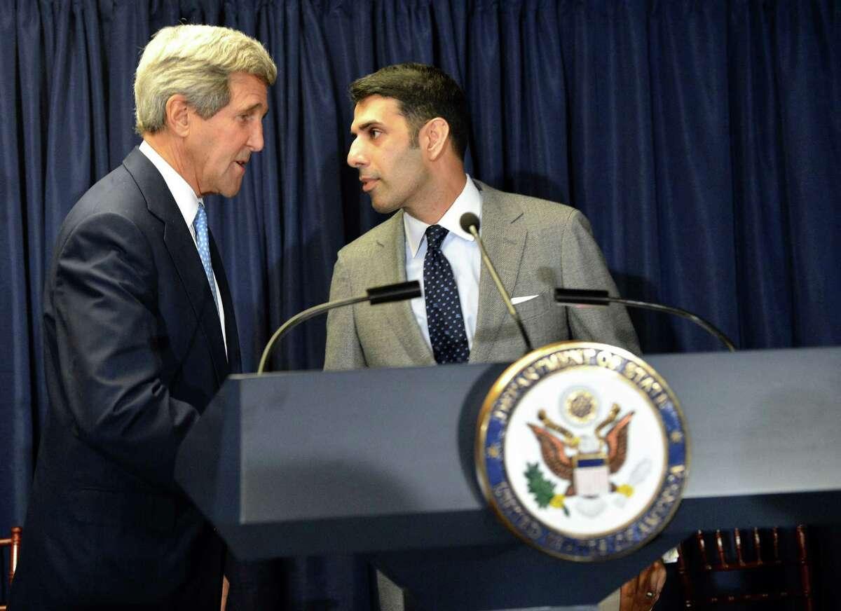 Secretary of State John Kerry introduced special envoy to Muslim communities Shaarik Zafar during an Eid reception on Oct. 16, 2014.