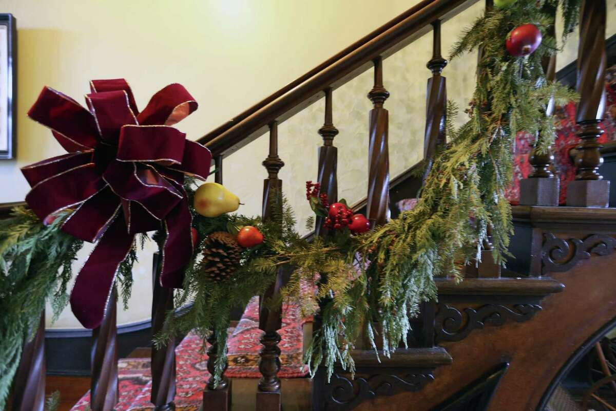 Living garland hangs on the banister of the three-story stairway in the Steves Homestead in the King William Historic District in 2016.