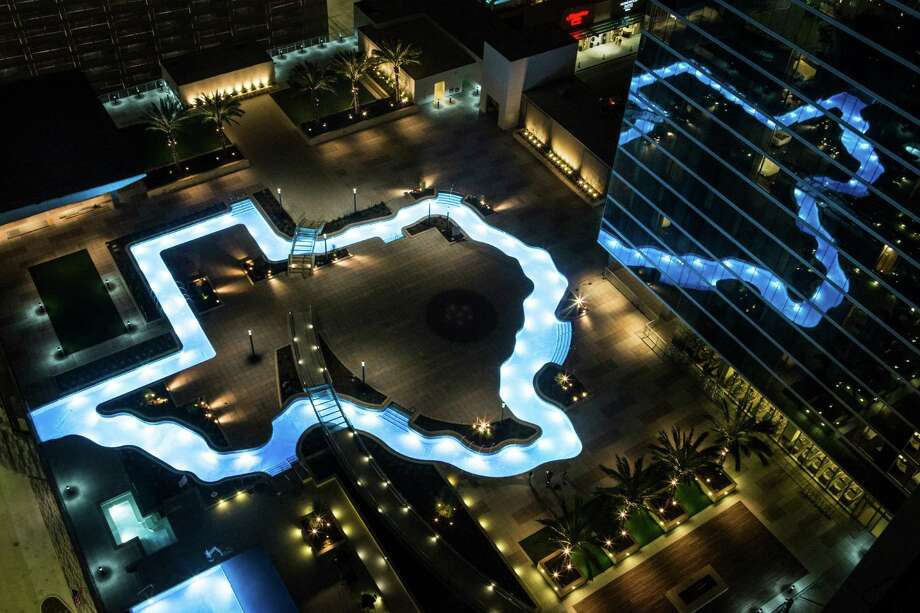 The Texas-shaped lazy river pool is lit up during the grand lighting ceremony at the Marriott Marquis hotel on Dec. 26. Photo: Brett Coomer, Houston Chronicle / © 2016 Houston Chronicle