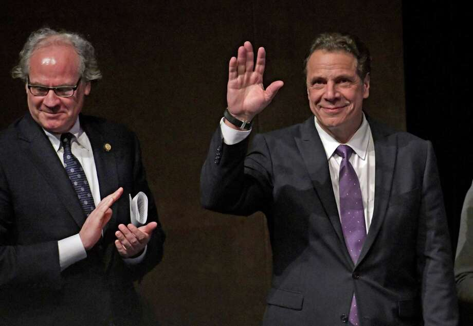 Governor Andrew Cuomo waves to the audience at the Regional Economic Development Council Awards where the Capital Region won a Top Performer Award and a check for $83.1M. Thursday  Dec. 8, 2016 In Albany, N.Y. Joining the Governor is Howard Zemsky, president and CEO of Empire State Development Council.   (Skip Dickstein/Times Union) Photo: SKIP DICKSTEIN / 20039083A
