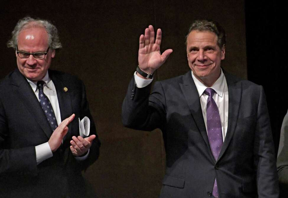Governor Andrew Cuomo waves to the audience at the Regional Economic Development Council Awards where the Capital Region won a Top Performer Award and a check for $83.1M. Thursday Dec. 8, 2016 In Albany, N.Y. Joining the Governor is Howard Zemsky, president and CEO of Empire State Development Council. (Skip Dickstein/Times Union)