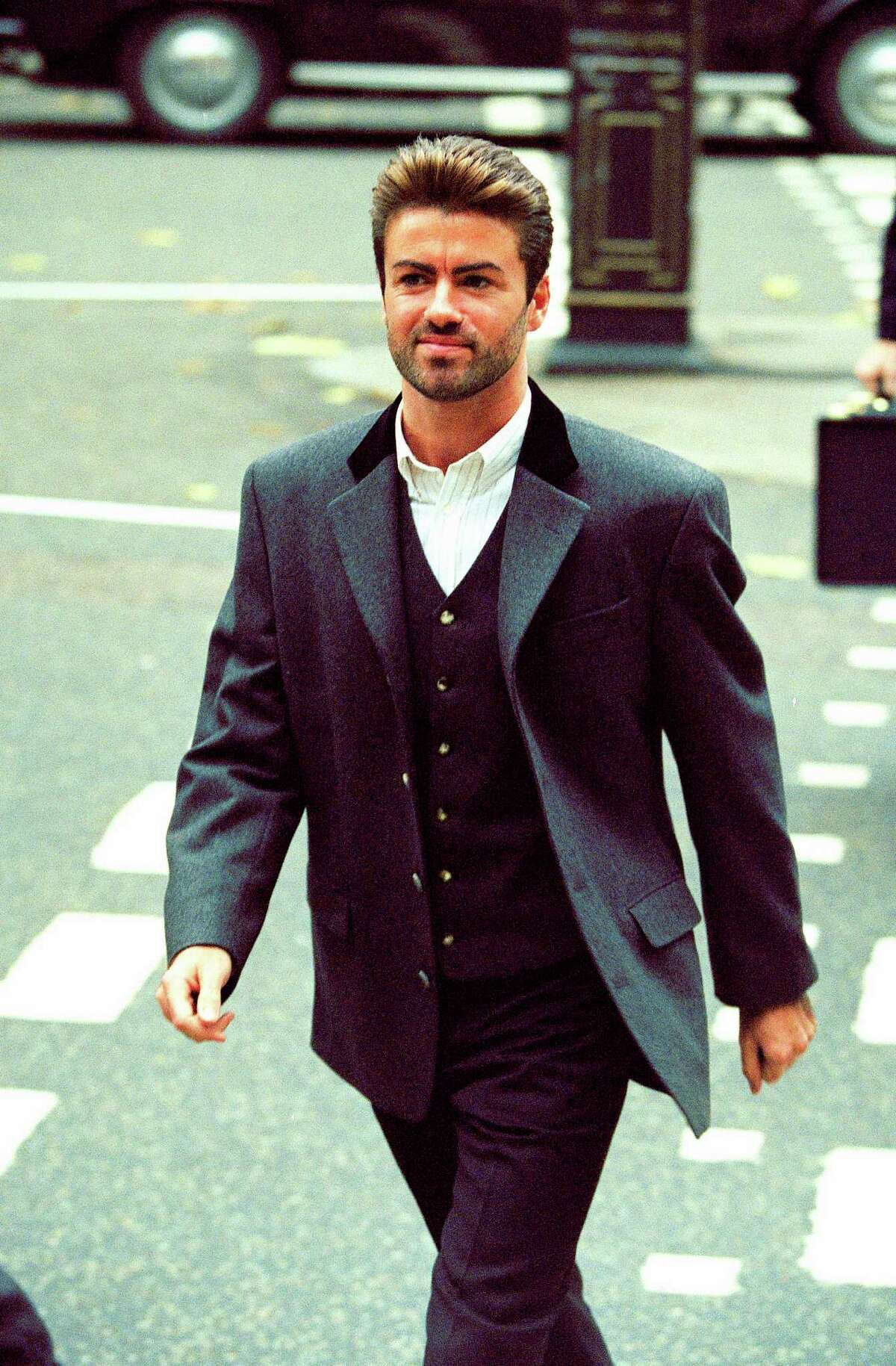 FILE - In this Oct. 28, 1993, file photo, pop star George Michael arrives to give evidence at the Royal Courts of Justice in London. Michael was petitioning the court to release him from his contract with Sony Music Entertainment (UK) Ltd. Michael, who rocketed to stardom with WHAM! and went on to enjoy a long and celebrated solo career lined with controversies, has died, his publicist said Sunday, Dec. 25, 2016. He was 53. (AP Photo/Alistair Grant) ORG XMIT: NYGM106