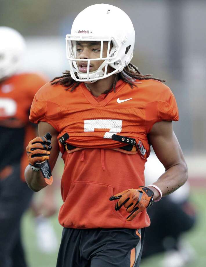 Ramon Richards warms up as the Oklahoma State Cowboys work out at Almo Heights High School on December 23, 2016. Photo: Tom Reel / Express-News / 2016 SAN ANTONIO EXPRESS-NEWS