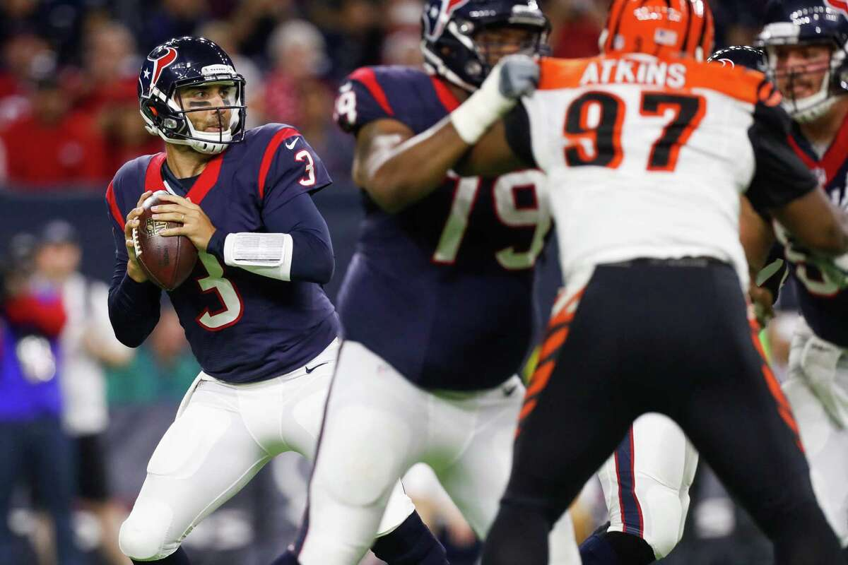 Texans quarterback Tom Savage, left, looks for a way to generate more offense for a team that has had precious little of it this season. He has completed 41-of-65 for 436 yards over the past 11/2 games.