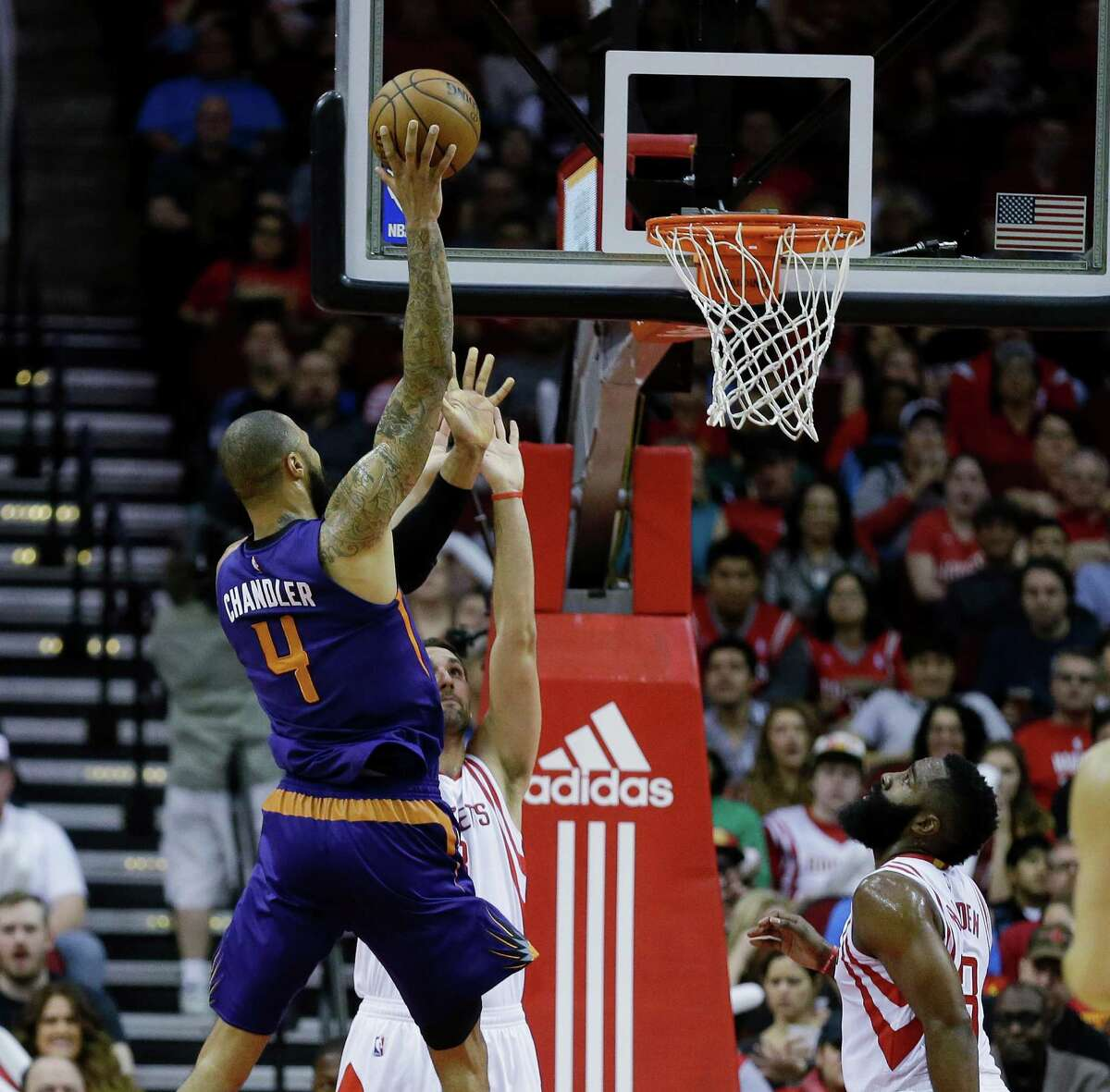 Phoenix Suns center Tyson Chandler (4) shoots over Houston Rockets forward Ryan Anderson (3) as guard James Harden (13) looks on in the first half of an NBA basketball game on Monday, Dec. 26, 2016 in Houston. (AP Photo/Bob Levey)