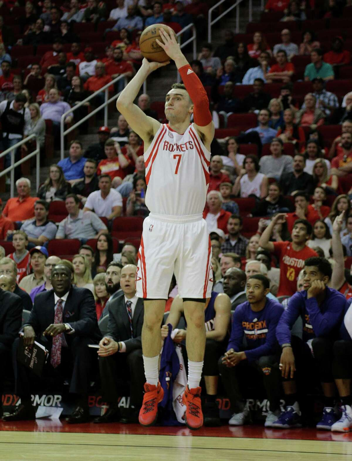 Houston Rockets forward Sam Dekker (7) shoots a three-point shot against the Phoenix Suns in the first half of an NBA basketball game on Monday, Dec. 26, 2016 in Houston. (AP Photo/Bob Levey)