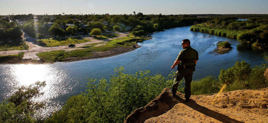 Border Patrol agent Isaac Villegas looks over the Rio Grande River into Mexico Wednesday, Nov. 16, 2016 in Roma.Keep clicking to see a gallery of other images from the U.S.-Mexico border. Photo: Michael Ciaglo/Houston Chronicle