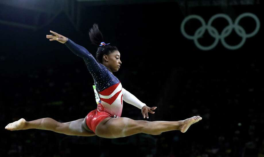 FILE - In this Aug. 9, 2016 file photo, United States' Simone Biles performs on the balance beam during the artistic gymnastics women's team final at the Summer Olympics in Rio de Janeiro, Brazil. Briles was selected as the AP Female Athlete of the Year, on Monday, Dec. 26, 2016. (AP Photo/Rebecca Blackwell, File) ORG XMIT: NY150 Photo: Rebecca Blackwell / Copyright 2016 The Associated Press. All rights reserved. This m