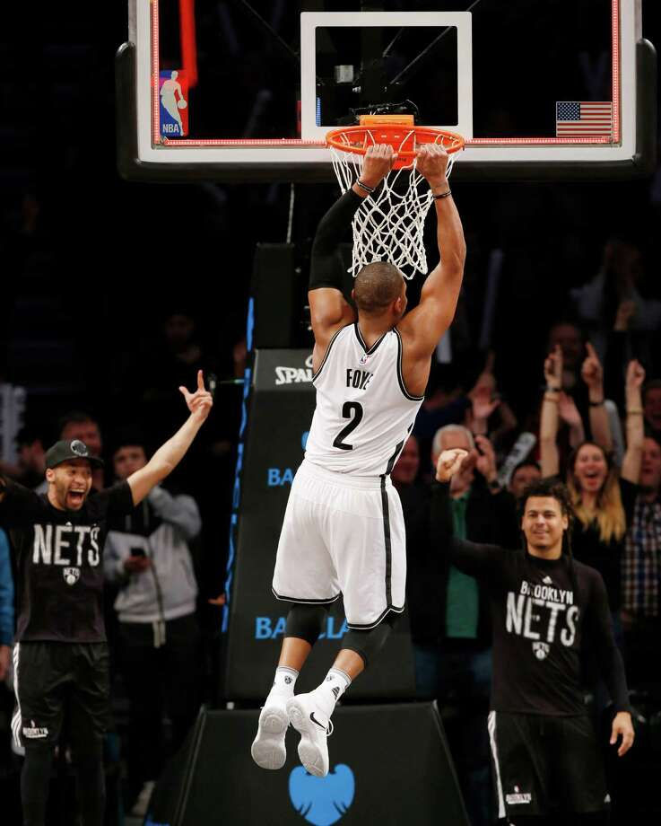 Brooklyn Nets guard Randy Foye (2) hangs onto the rim of the Hornets' basket after sinking a three-pointer in the final two seconds of the fourth quarter of an NBA basketball game against the Charlotte Hornets, Monday, Dec. 26, 2016, in New York. The Nets upset the Hornets 120-118. (AP Photo/Kathy Willens) ORG XMIT: NYKW113 Photo: Kathy Willens / Copyright 2016 The Associated Press. All rights reserved.