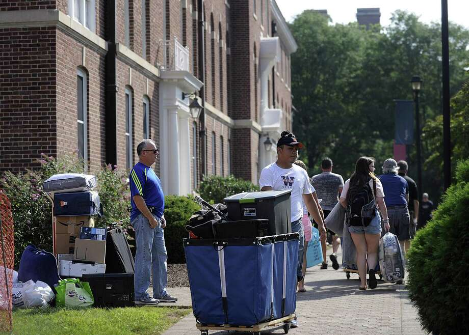 Students move in to the Fairfield Hall dorm at Western Connecticut State University earlier this year. The university, in its annual crime report, credits educational programs with the decline in on-campus drinking. Photo: Hearst Connecticut Media File Photo / The News-Times