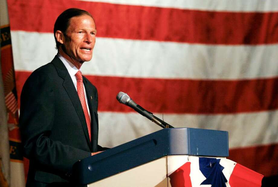 Attorney General Richard Blumenthal gives a short address at a ceremony honoring military personnel at Weston High School on Sunday, May 23, 2010, Blumenthal's first public appearance in a military setting since the recent scandal. Blumenthal has apologized in an e-mail for misstatements about his military service during the Vietnam War, nearly a week after the controversy erupted. Photo: Laura Buckman / Connecticut Post