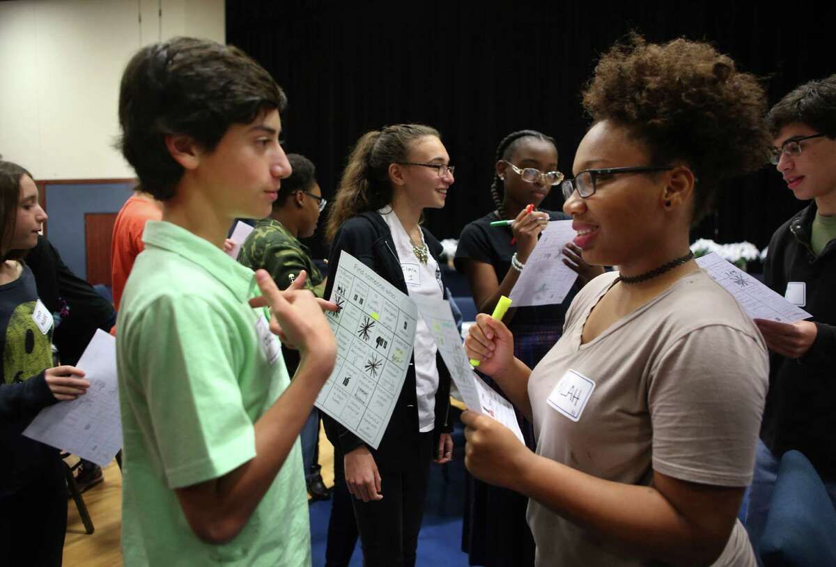 Gabe Sondock, 14, and Kilah Murphy, 16, talk while playing a scavenger hunt bingo game during an event inviting members of Congregation Beth Yeshurun to spend an evening of fellowship with members of The Church of Bethelé?•s Family, Sunday, Nov. 20, 2016, in Houston. ( Mark Mulligan / Houston Chronicle )