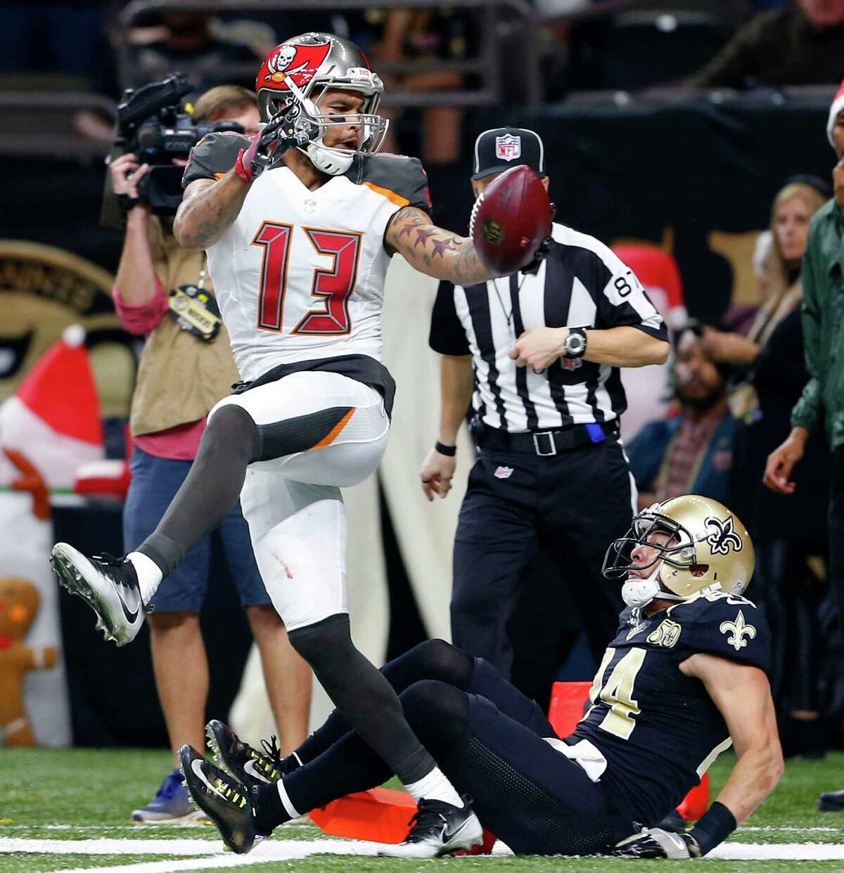 Tampa Bay Buccaneers wide receiver Mike Evans (13) scores on a touchdown reception over New Orleans Saints cornerback Sterling Moore (24) in the second half of an NFL football game in New Orleans, Saturday, Dec. 24, 2016. (AP Photo/Butch Dill)