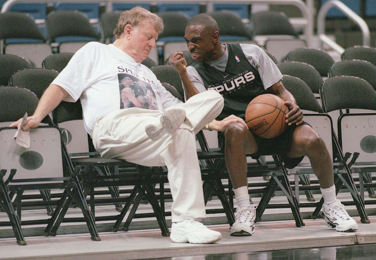 Guard Avery Johnson talks with then-former Spurs owner Red McCombs during the 1999 playoff run.