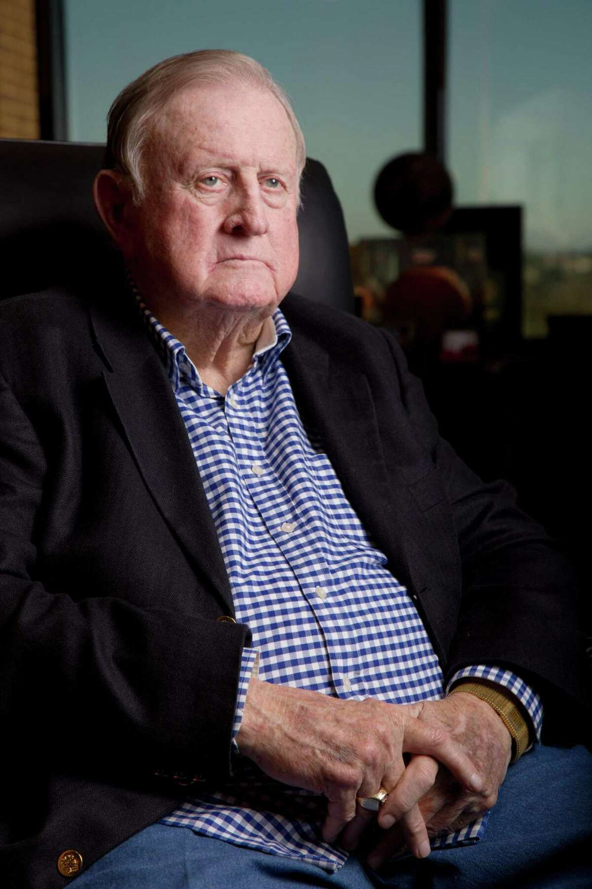 """San Antonio billionaire B.J. """"Red"""" McCombs is suing former executives of his McCombs Energy for alleging starting a competing company while still employed at McCombs Energy."""