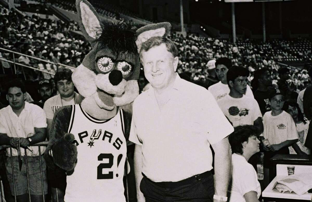 Red McCombs, former majority owner of the Spurs, poses with the team mascot, the Coyote, in this undated photo.