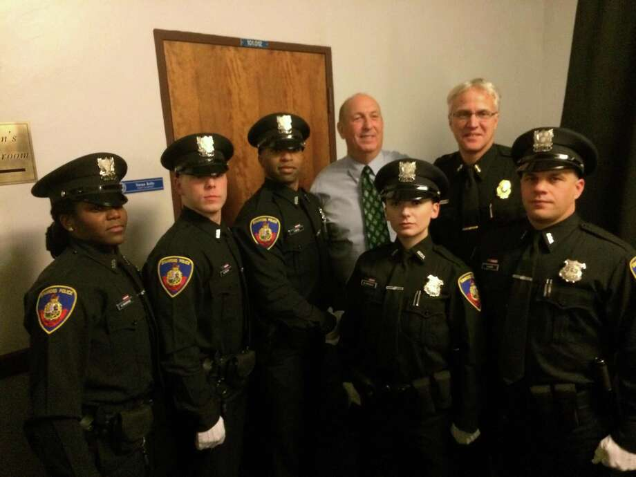 Five officers graduated this month from the police academy. From left, Officers Kemesha Woodfine, Brandon Brown and Terry Bates, Stamford Police Chief Jon Fontneau, Officer Melaine Miscioscia, Assistant Chief Thomas Wuennemann and Officer Rocco Cipri. Photo: Contributed / Contributed