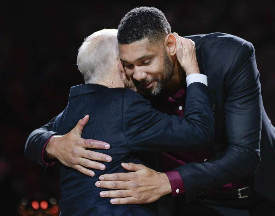 Tim Duncan hugs Dave Odom, his college basketball coach at  Wake Forest. Photo: Darren Abate /Associated Press / FR115 AP