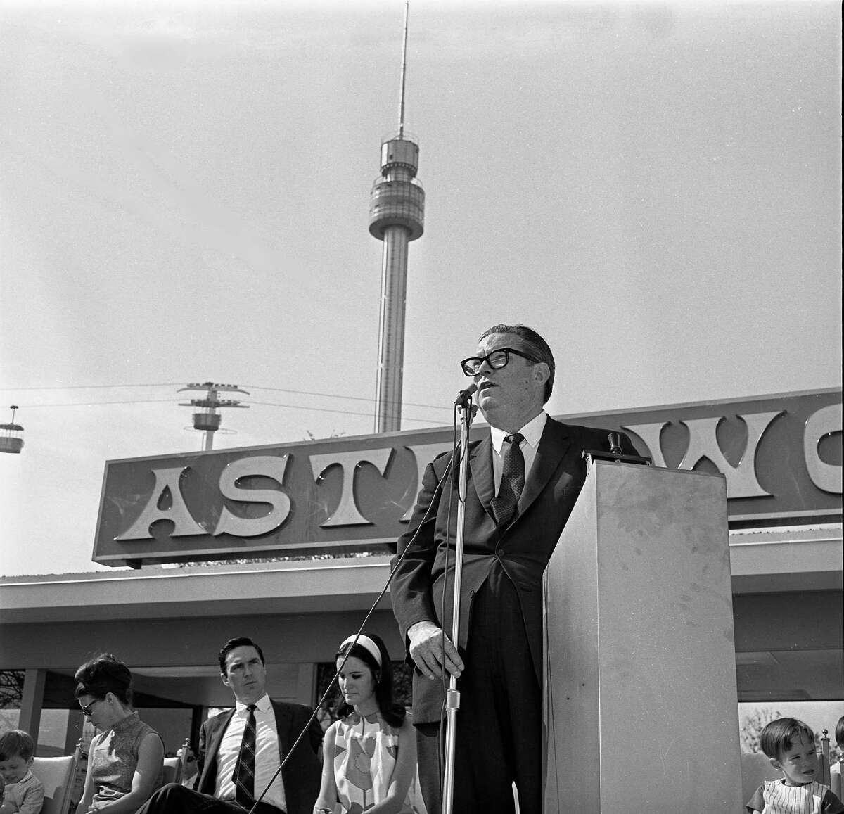 06/01/1968 - Roy Hofheinz welcomes visitors at opening ceremonies for Astroworld, his new 57-acre amusement park in the Astrodomain complex in Houston. His son, Fred, and daughter, Dene, are seen behind him on the platform in front of the park gates.