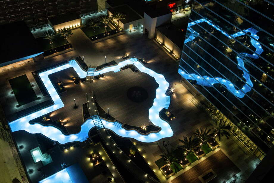 The Texas-shaped lazy river pool is lit up during the grand lighting ceremony at the Marriott Marquis hotel on Monday, Dec. 26, 2016, in Houston. Photo: Brett Coomer, Houston Chronicle / © 2016 Houston Chronicle