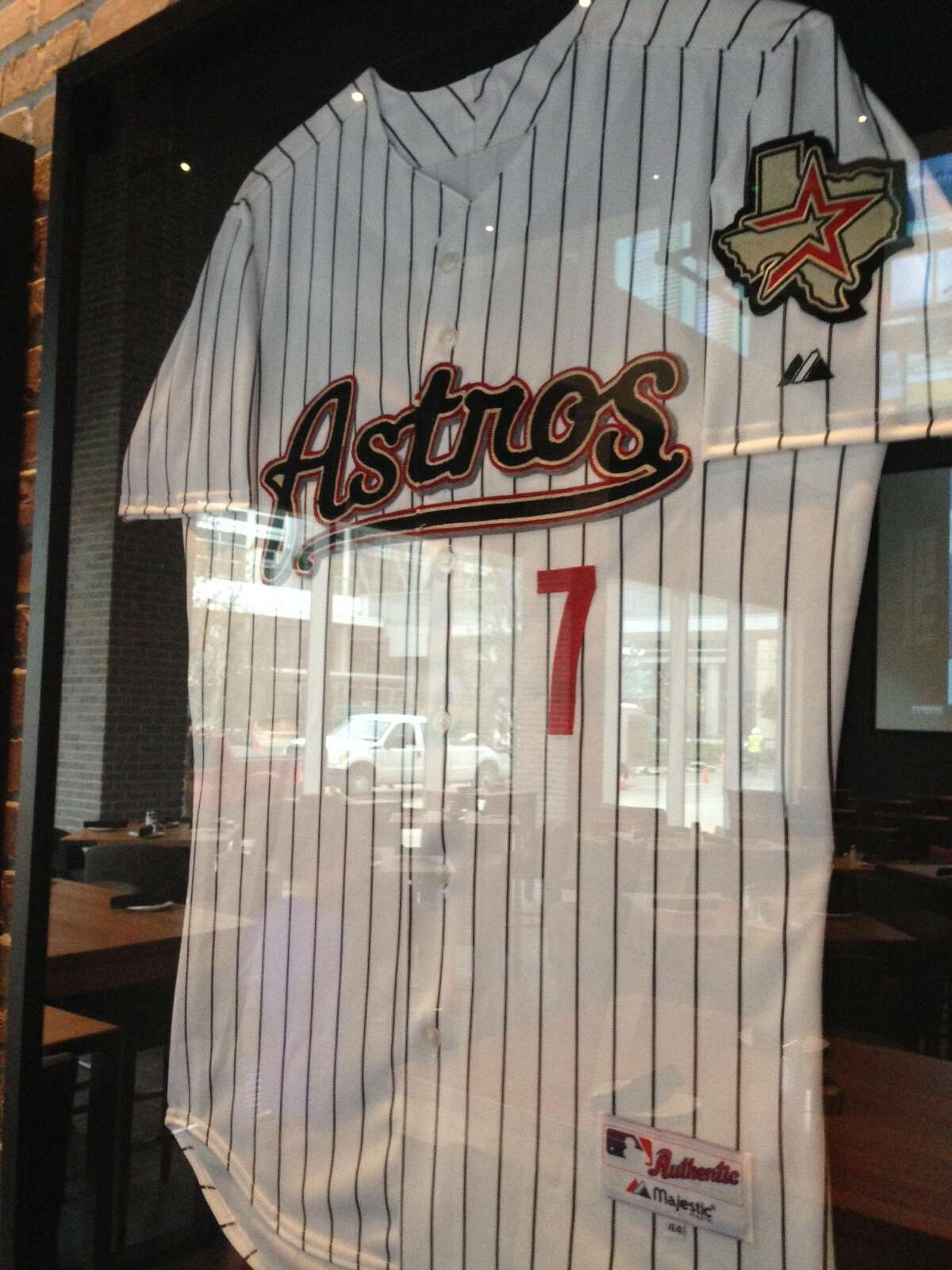 Biggio's, a sports bar that is a partnership between the former Astros star Craig Biggio and Marriott, opened at the 1,000-room Marriott Marquis Houston. Shown: Sports memorabilia.