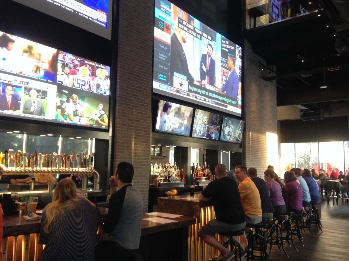 Biggio's, a sports bar that is a partnership between the former Astros star Craig Biggio and Marriott, opened at the 1,000-room Marriott Marquis Houston. Shown: The downstairs bar of the two-level restaurant.