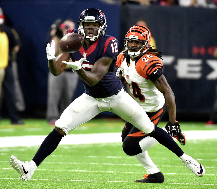 Houston Texans' Keith Mumphery (12) catches a pass as Cincinnati Bengals' Adam Jones (24) defends during the second half of an NFL football game Saturday, Dec. 24, 2016, in Houston. (AP Photo/Eric Christian Smith) Photo: Eric Christian Smith/Associated Press