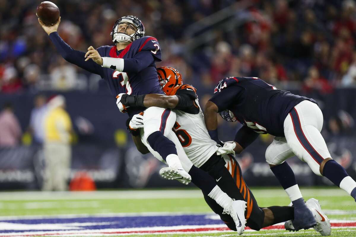 Houston Texans quarterback Tom Savage (3) throws the ball while being tackled by Cincinnati Bengals defensive end Carlos Dunlap (96) during the third quarter of an NFL football game at NRG Stadium, Saturday,Dec. 24, 2016 in Houston. ( Karen Warren / Houston Chronicle )