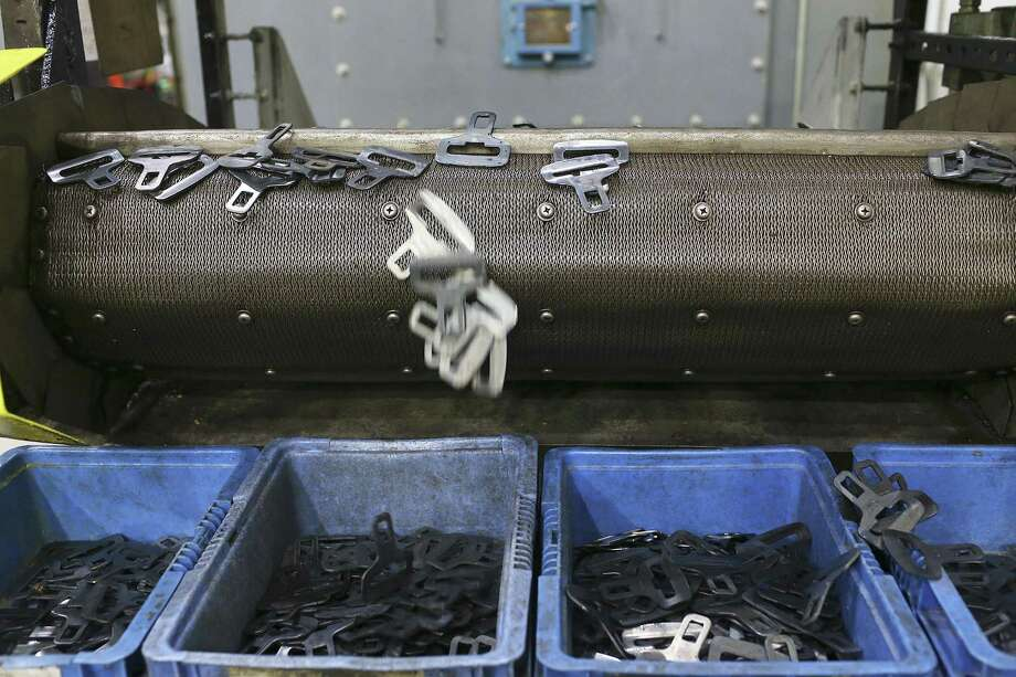 Seat belt parts fall off a conveyor belt at TK Holding Inc., a Takata-owned manufacturer in San Antonio. Photo: San Antonio Express-News File Photo / © 2016 San Antonio Express-News