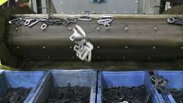 Seat belt parts fall off a conveyor belt at TK Holding Inc., a Takata-owned manufacturer in San Antonio.