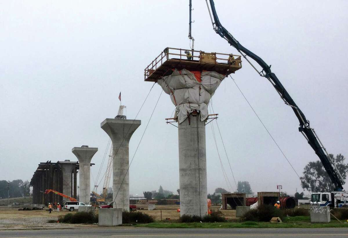 Contractors for the California High-Speed Rail Authority erect a viaduct for elevated high-speed rail tracks near Cedar and North avenues and State Route 99 in Fresno, California, in this Dec. 6, 2016 photo. Aerial structures similar to these might be built in Fairfield County for Amtrak trains, roughly following Interstate 95.