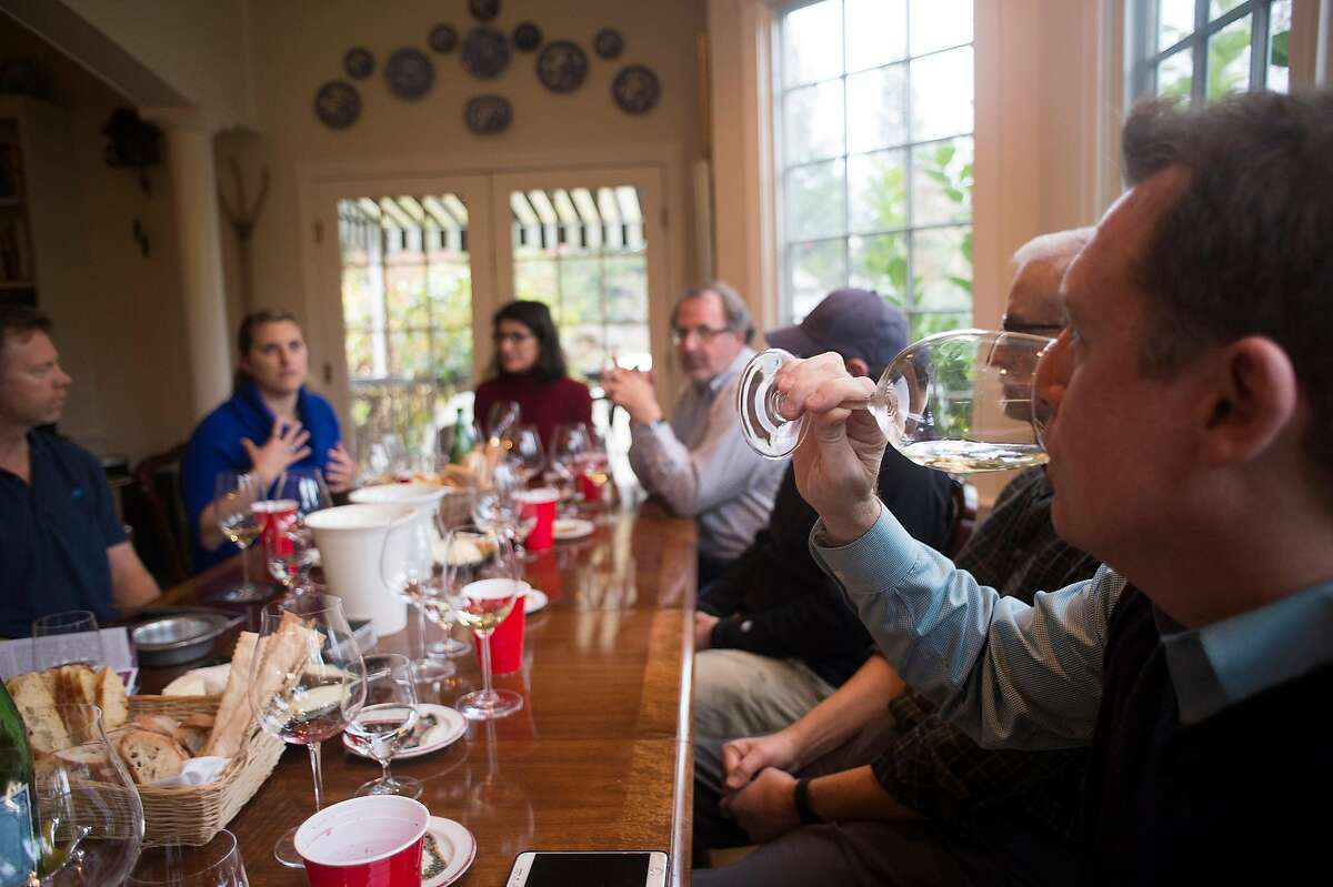 A group of vintners meet at the Forestville home of Trombetta Family Wines owner, Rickey Trombetta Stancliff, to taste wines from what is expected to be announced as a new American Viticultural Area in Sonoma County, named the Petaluma Gap on Dec. 15, 2016.