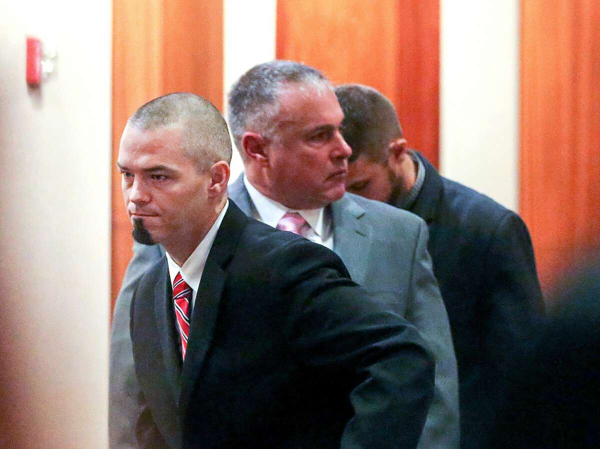 Paul Slayton, left, better known as the Houston rapper Paul Wall, is seen in the 262nd Criminal Court, at the Harris County Criminal Justice Center, Tuesday, Dec. 27, 2016, in Houston. Slayton is accused of being part of a conspiracy to sell marijuana and marijuana oil. ( Jon Shapley / Houston Chronicle )