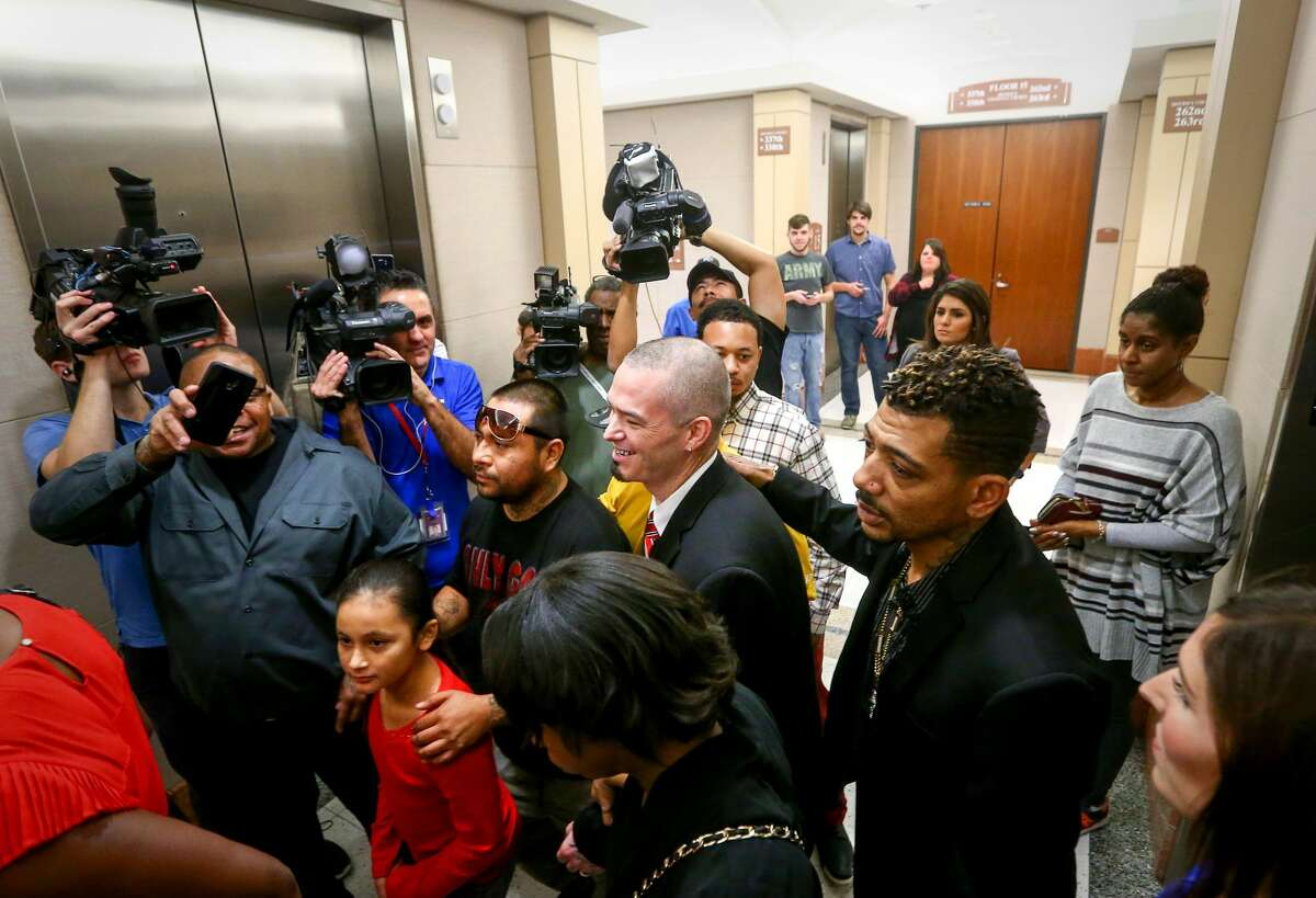 Paul Slayton, better known as the Houston rapper Paul Wall, is surrounded by fans and members of the media after leaving the 262nd Criminal Court, at the Harris County Criminal Justice Center, Tuesday, Dec. 27, 2016, in Houston. Slayton is accused of being part of a conspiracy to sell marijuana and marijuana oil. ( Jon Shapley / Houston Chronicle )