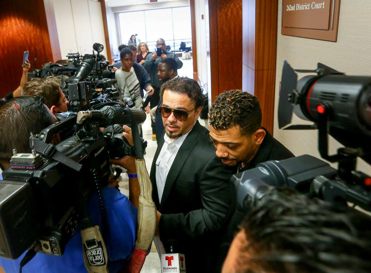 Ronald Bryant, center, better known as rapper Baby Bash, is surrounded by members of the media while he leaves the 262nd Criminal Court, at the Harris County Criminal Justice Center, Tuesday, Dec. 27, 2016, in Houston. Bryant is accused of being part of a conspiracy to sell marijuana and marijuana oil. ( Jon Shapley / Houston Chronicle )