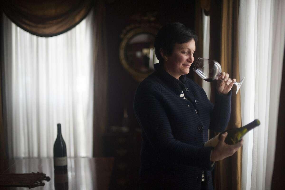 Ana Keller, proprietor of Keller Estate, tastes a bottle of her wine made from a Petaluma Gap vineyard.