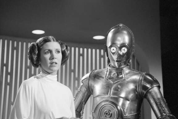 Carrie Fisher (as Princess Leia) and Anthony Daniels (as C3PO), 1978,,