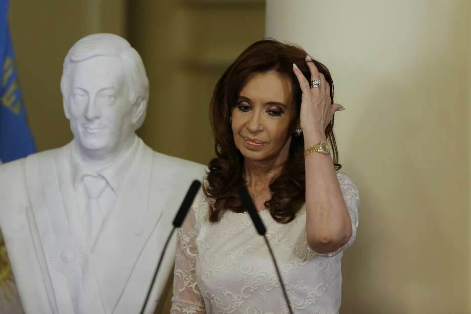 "Cristina Fernandez, who stands by a bust of her late husband, was indicted for ""illicit association."" Photo: Ricardo Mazalan, Associated Press"