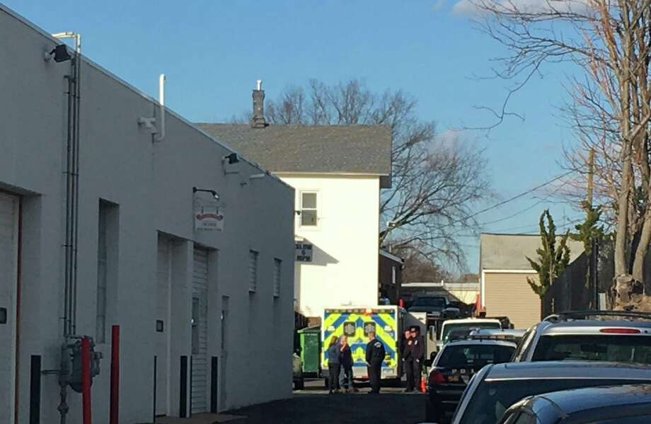 Police are investigating after a man fell from a two-story building on Broad Street in Norwalk on Tuesday. The flat-roofed building, which houses Fastenal, Overhead Door Co., and Norwalk Cross-Fit, is approximately 20 to 25 feet in height. Photo: Leslie Lake / Hearst Connecticut Media / Norwalk Hour