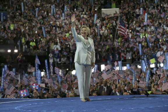 Hillary Clinton takes the stage to accept the presidential nomination at the Democratic National Convention in Philadelphia July 28. He love of pantsuits inspired a flashmob.