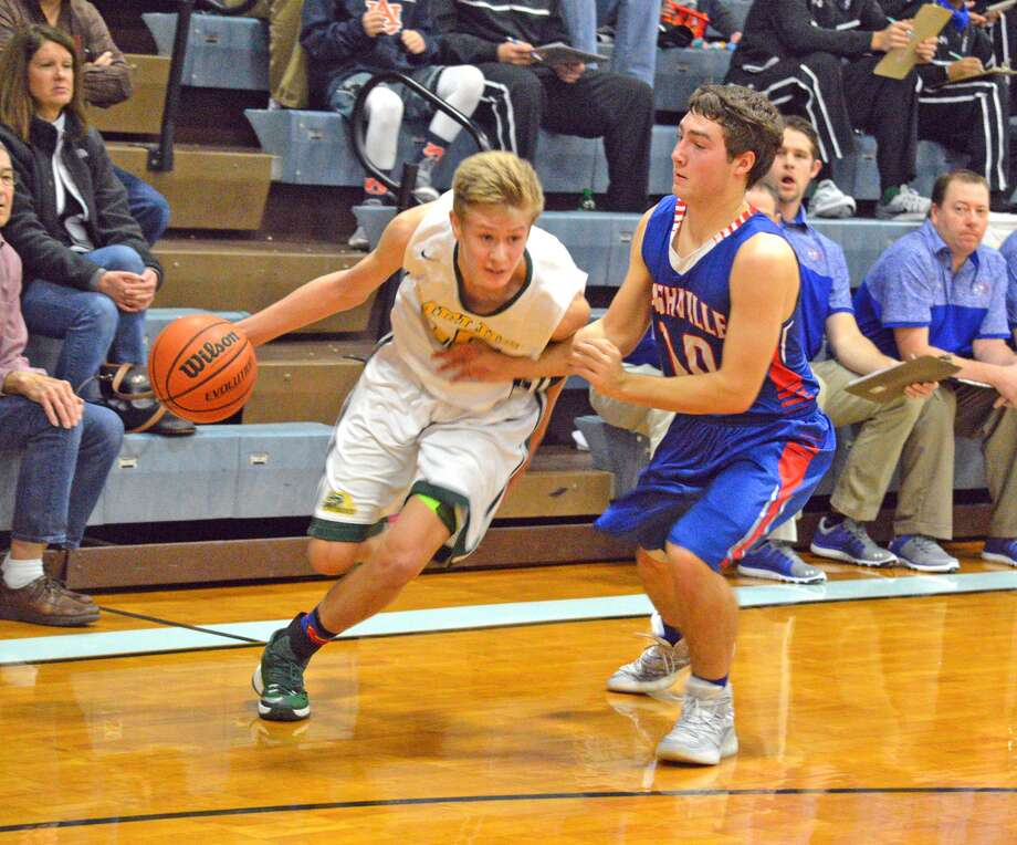 Metro-East Lutheran senior Noah Coddington, left, tries to dribble past Nashville's Hayden Heggemeier during Tuesday's opening game at the Mater Dei Holiday Tournament.