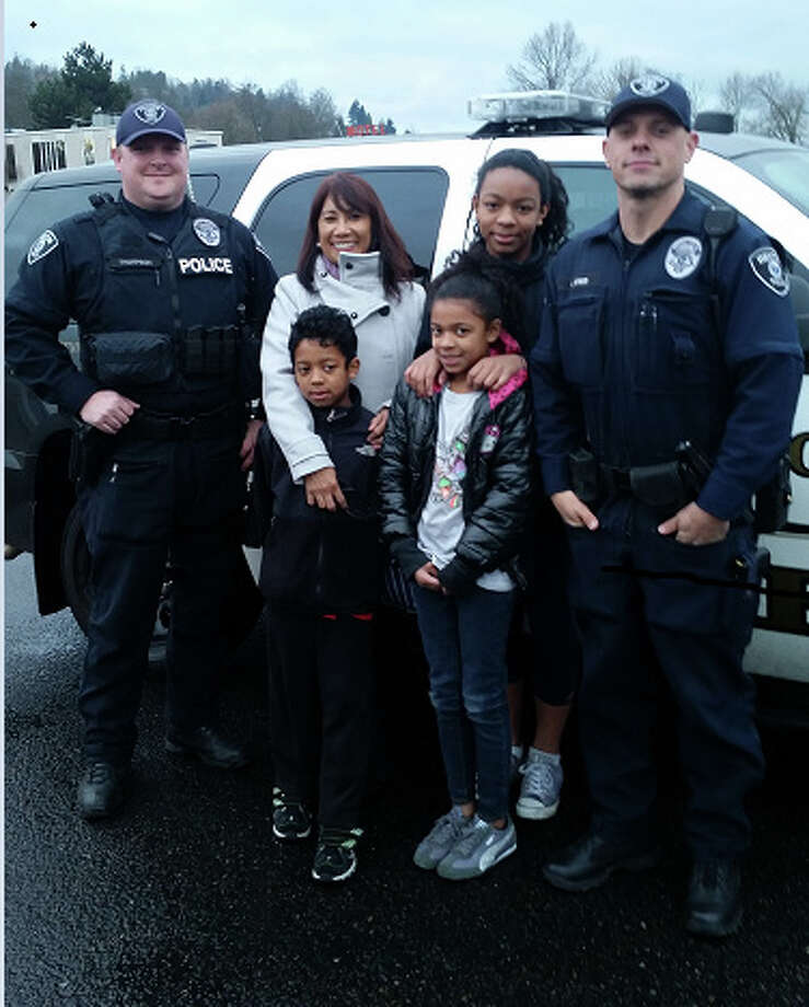 Renton police picked up grandma from the Sea-Tac airport Christmas Eve after her family (pictured) was stranded in a car crash. Photo: Renton Police Department