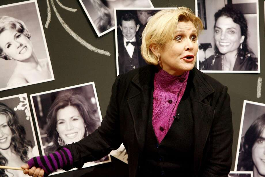 "Carrie Fisher explaining the complicated marriages and divorces of her family in ""Wishful Drinking,"" her solo show at Berkeley Repertory Theatre's Roda Theater in 2008. Photo: Katy Raddatz, The Chronicle"