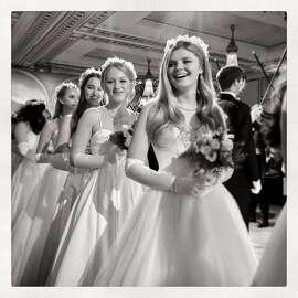 75th Cotillion debutantes Renee Hanneken (front) is followed by Haley Hunter, Katrina Keating and Megan McMicking at the Palace Hotel. Dec 2016.