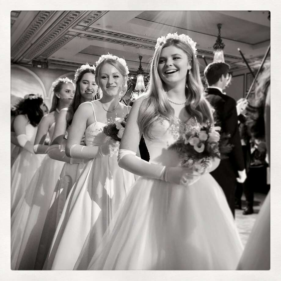 Seventy-fifth Cotillion debutante Renee Hanneken (front) is followed by Haley Hunter, Katrina Keating and Megan McMicking at the Palace Hotel Dec. 22, 2016. Photo: Catherine Bigelow, Special To The Chronicle