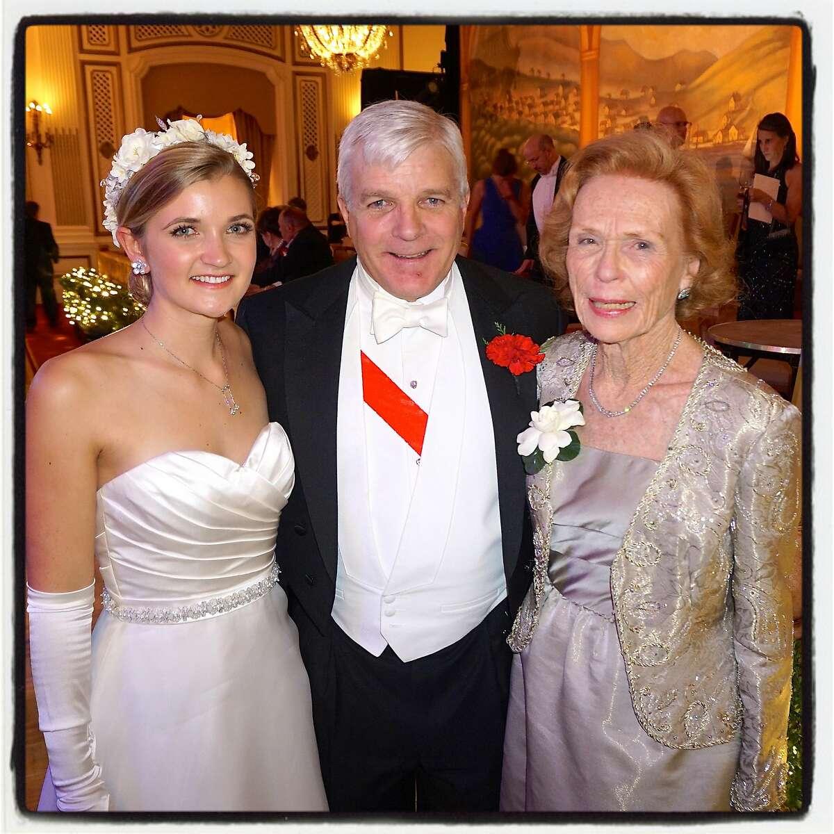 Debutante Grace Callander (left) with her dad, Clark Callander, and grandmother Barbara Callander at the Cotillion. Dec 2016.