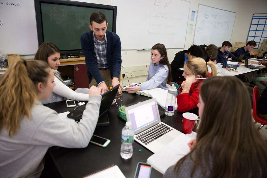 Brian Walach assists his students with a math problem in the Greenwich High School Innovation Lab on Thursday, December 15, 2016. Photo: Chris Palermo / For Hearst Connecticut Media / Greenwich Time Freelance