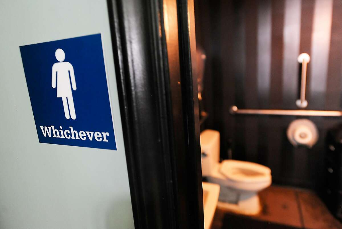 FILE-- A gender neutral sign is posted outside a bathrooms at Oval Park Grill on May 11, 2016 in Durham, North Carolina. Debate over transgender bathroom access spreads nationwide as the U.S. Department of Justice countersues North Carolina Governor Pat McCrory from enforcing the provisions of House Bill 2 (HB2) that dictate what bathrooms transgender individuals can use.