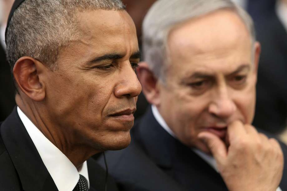 """FILE -- In this Sept. 30, 2016 file photo, US President Barack Obama, left, and Israeli Prime Minister Benjamin Netanyahu talk during the funeral of former Israeli President and Prime minister Shimon Peres in Jerusalem. Doubling down on its public break with the Obama administration, a furious Israeli government says it has """"ironclad"""" information from Arab sources that Washington actively helped craft last week's U.N. resolution declaring Israeli settlements illegal. The allegations further poison the increasingly toxic atmosphere between Israel and the outgoing Obama administration in the wake of Friday's vote, and raise questions about whether the White House might take further action. (Menahem Kahana, Pool via AP, File) Photo: MENAHEM KAHANA, Associated Press"""