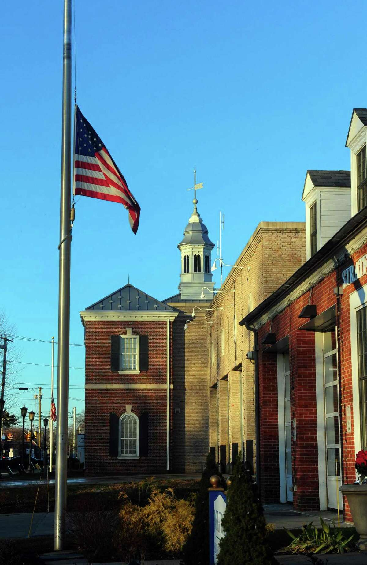 A flag flies at half staff in the front of the Stratford Fire Department on Main Street in Stratford, Conn., in this Dec. 27, 2016, file photo.